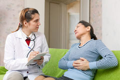 Patient complaining of pain in heart to doctor Stock Photo