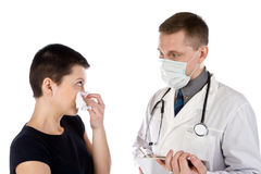 The patient complains to the doctor of illness. The girl complains to the doctor of illness Royalty Free Stock Photo