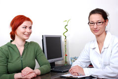 Patient in consultation with a female doctor Royalty Free Stock Images