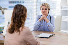 Patient consulting a doctor Stock Photography