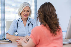 Patient consulting a doctor Stock Image