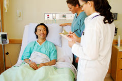 Patient conversing with staff Stock Photos