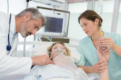 Patient in critical condition. Work stock photos