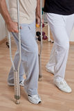 Patient on Crutches and Physician. Patient on crutches discusses his progress Royalty Free Stock Photo