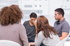 Patient crying during a group session. Patient crying during group therapy session Royalty Free Stock Image