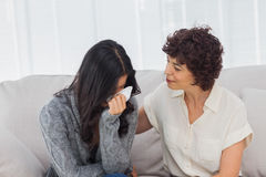 Patient crying next to her therapist. While she is comforting her Royalty Free Stock Images