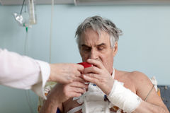 Patient with a cup of tea. In a hospital ward Stock Image