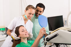 Patient in the dental clinic. Happy european patient in the dental clinic stock images
