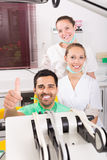 Patient in the dental clinic. Happy young patient in the dental clinic stock image