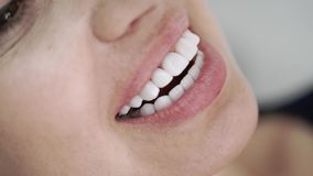 Patient in dental clinic. On chair smiling with veneers stock video