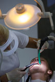 Patient at dental hygienists office Stock Photo