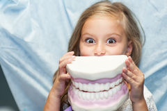 Patient is in the dental office. Young patient learns to brush your teeth in the dental office stock photography