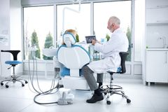The patient and dentist are consulted about treatment of teeth. In  dental office Stock Images