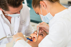 Patient with Dentist - dental treatment Royalty Free Stock Images