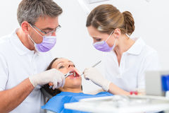 Patient with Dentist - dental treatment Stock Photo