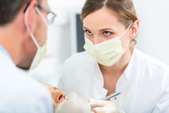 Patient with Dentist - dental treatment Royalty Free Stock Photos