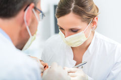 Patient with Dentist - dental treatment Stock Image