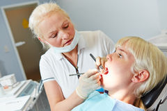 Patient at dentist for dental treatment Stock Images