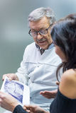 Patient and dentist holding xray. Stock Photography