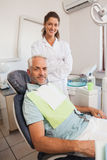 Patient and dentist smiling at camera Royalty Free Stock Photo