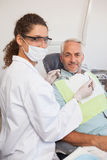 Patient and dentist smiling at camera Stock Photography
