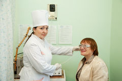 Patient and doctor during  physiotherapy Royalty Free Stock Photos