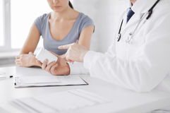 Patient and doctor prescribing medication Stock Photos