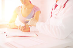 Patient and doctor prescribing medication stock photos