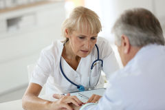 Patient at doctor's getting a checkup Stock Photos