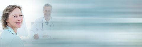 Patient and doctor smiling. Digital composite of Patient and doctor smiling Royalty Free Stock Photography