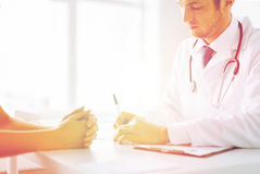 Patient and doctor taking notes Stock Photo