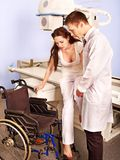 Patient and doctor in x-ray room. Royalty Free Stock Photography