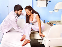 Patient and doctor in x-ray room. Stock Photography