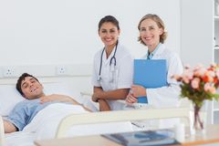 Patient and doctors looking at the camera Royalty Free Stock Photo
