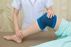 Patient  doing physical exercises with physical therapist Royalty Free Stock Image