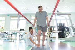 Patient doing physical therapy. Physical stock images
