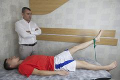 Patient doing some special exercises under supervision of physic royalty free stock photo