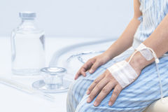 Patient is on drip receiving a saline solution stock photography