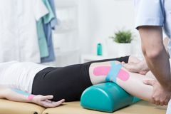 Patient with elastic therapeutic tape Stock Images