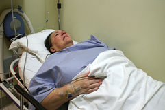 Patient in Emergency Room Bed Royalty Free Stock Images