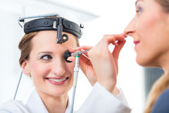 Patient in a examination by doctor in clinic Royalty Free Stock Photos