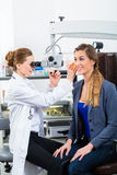 Patient in a examination by doctor in clinic. Doctor - Young female doctor or ENT specialist - with a patient in her practice, examining the ear with a endoscope Royalty Free Stock Photos