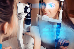 Patient during an eye examination at the eye clinic. Patient during an eye examination at the eye future clinic. Ophthalmologist. Virtual sensors for vision royalty free stock photo
