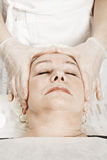 Patient at face massage Stock Photos
