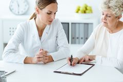 Patient filling in medical questionnaire Stock Images