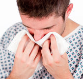 Patient with flu sneezing Royalty Free Stock Images