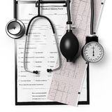 Patient form and cardiogram with medical equipment Royalty Free Stock Photos