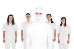 Patient in front of Healtcare Staff Stock Photography