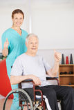 Patient and geriatric nurse holding thumbs up Stock Photography