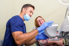 A patient getting attended and treatment in a dental studio stock images